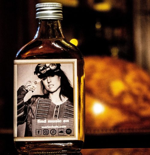 chain rye whiskey bottle with marie chain photo