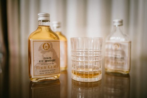 marie chain rye whiskey in glas and bottles